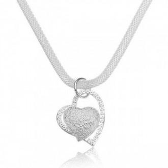 Collier et pendentif en forme de cœur argenté